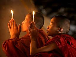 cinesi in preghiera
