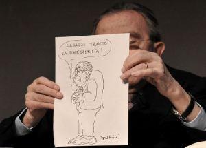 Giulio Andreotti con una vignetta di Forattini