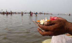 Varanasi. Flower offer to Ganga river