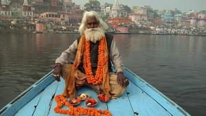 Varanasi. Sadu praying on the boat