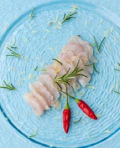 Ricciola marinated in oil, rosemary and chile at Oresteria