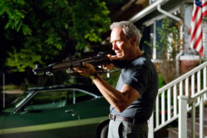 Gran Torino. Clint with american flag